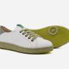 zapatillas blancas de suela verde sneakers